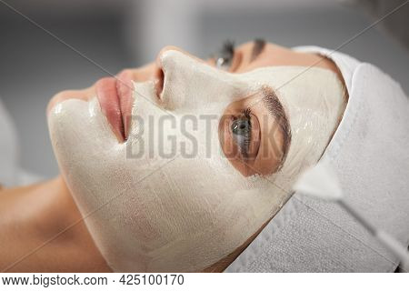 Side View Portrait Of Beautiful Young Woman On Procedure Peeling For Improvements Skin Face In Beaut