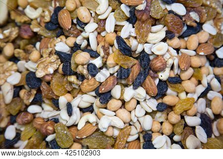 Nut Mixture Of Raisins, Walnuts, Cashews, Hazelnuts, Selective Focus. Fruits Nuts Vegetables Berries