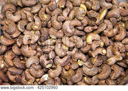 Indian Walnut Or Cashew Roasted Brown With A Beautiful Pattern Of The Peel. Fruits Nuts Vegetables B