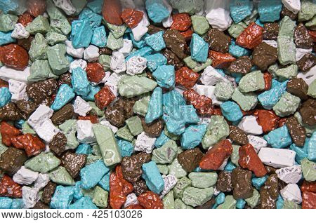 Candy Chocolate Sugar Stones Of Various Colors With A Beautiful Structure Similar To Stones. Fruits
