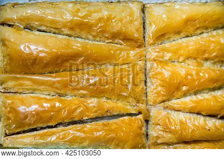 Oriental Sweets Baklava With Nuts In The Shape Of Pyramids. Fruits Nuts Vegetables Berries Useful Pr