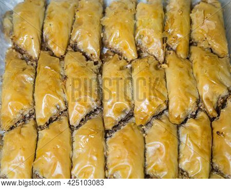 Oriental Sweets Baklava Made Of Golden Puff Pastry With Wrapped Nuts. Fruits Nuts Vegetables Berries