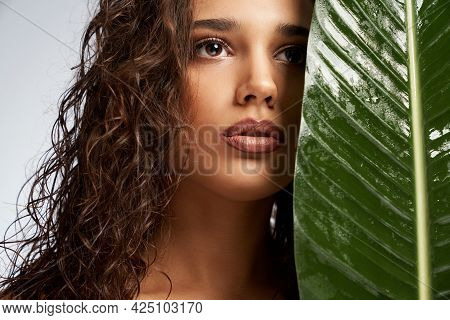 Crop Of Attractive Young Female Model Standing And Looking Up Isolated On White. Portrait Of Naked W