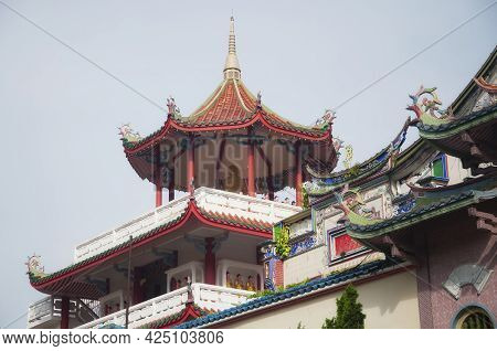 Various Architecture Within The Kek Lok Si Temple In Penang Malaysia On A Overcast Day.