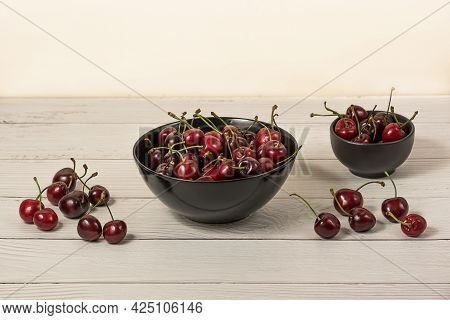 Bowl Full Of Ripe Red Dark Cherries On Wooden Table Surface As Source Of Vitamins, Organic Food