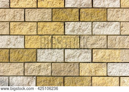 Brick Wall Texture. Background Image Of A Brick Wall. Yellow Brick Wall. Rough Brick Texture.