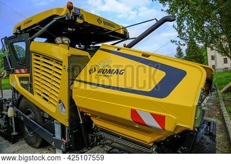 June 2021 Parma, Italy: Huge Yellow Bomag Heavy Road Machine Close-up Parked And Ready For Road Cons