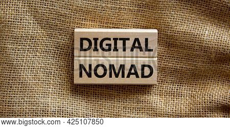 Digital Nomad Symbol. Wooden Blocks With Words Digital Nomad On Beautiful Canvas Background, Copy Sp