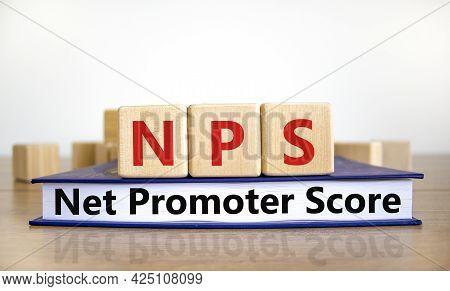 Nps Net Promoter Score Symbol. Wooden Cubes On Book With Words 'nps Net Promoter Score'. White Backg