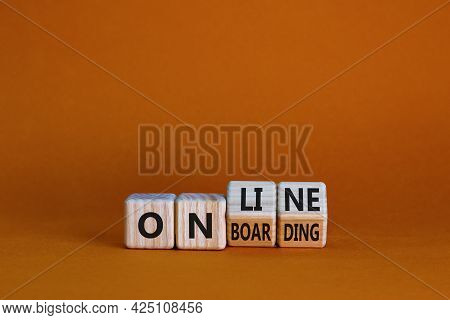 Online Onboarding Symbol. Turned Wooden Cubes With Words 'online Onboarding'. Beautiful Orange Table