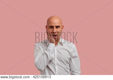 Unbelievable. Surprised Bald Man With Bristle In White Shirt, Staring At Camera With Shocked Look. K