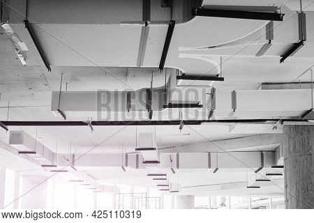 Shoot In Black And White Shot. Air Condition And Hvac System Installation Under Bare Skin Ceiling Be