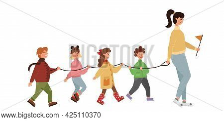 Kindergarten Group On An Autumn Walk With A Tutor. Happy Cheerful Children Go In A Row Holding A Spe
