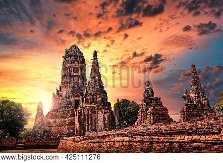 Buddhism Stupa In The Ancient Ruin Temple Of Ayutthaya Thailand With Sun Set Sky.