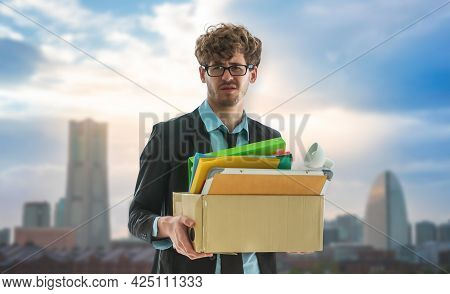 Unemployed Business Man Worker Carrying A Packed Box With Upset Expression For Unemployment Concept