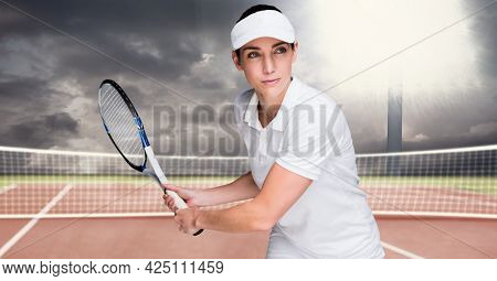 Composition of female tennis player holding tennis racket at tennis court. sport and competition concept digitally generated image.