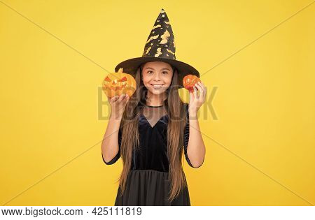 Happy Halloween. Child In Witch Hat. Kid Hold Spooky Pumpkin. Witchcraft And Enchantment. Childhood