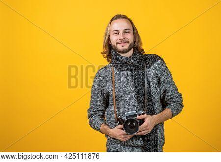 A True Shutterbug. Photographer Yellow Background. Photographer Hold Photo Camera.
