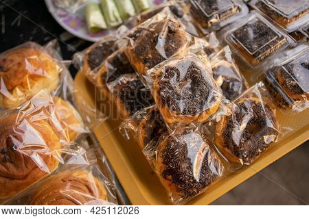 Donuts With Mesis Wrapped In Plastic On A Serving Plate On The Table
