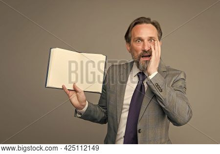 Businessman Surprised By Interesting Information In Book. Get Ready For Business Training. Successfu