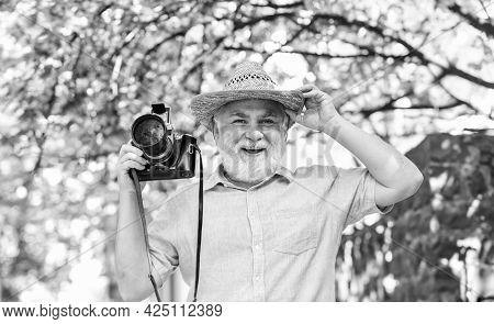 Spring Holidays. Travel Photo. Photographer In Blooming Garden. Enjoying Free Time. Travel And Touri