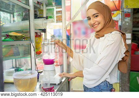 Ice Seller Hijab Girl Smiles While Holding Blender