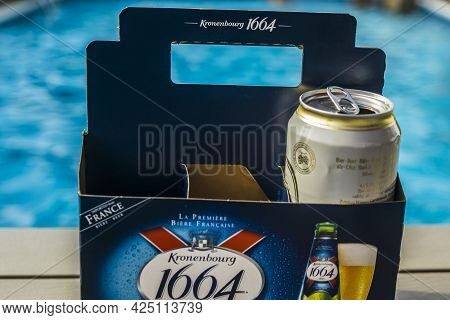 Toronto, Canada, August 2020 - French Beer Kronenbourg 1664 Box With One Open Can, By A Swimming Poo