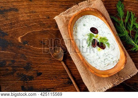 Traditional Greek Sauce Or Dip Tzatziki, Yogurt, Cucumber, Dill, Garlic And Salt Oil In Rustic Woode