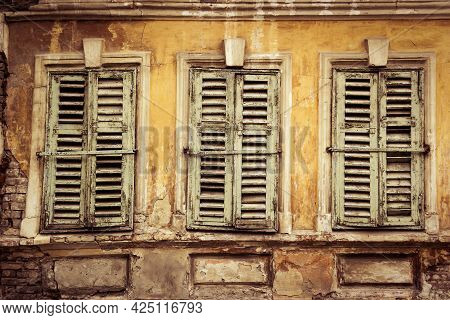 Old Windows And Shutters. Vintage Background And Texture. Old French Shutters