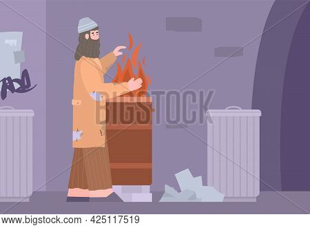 Poor Dirty Homeless Beggar In Torn Clothes Heating Hands Near Barrel With Fire