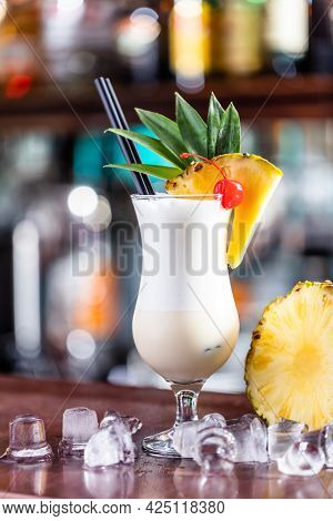 Pina colada coctail on bar counter with fresh pinapple