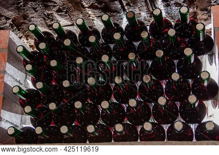 Wine Glasses Are Stacked On The Shelf In The Wine Cellar.