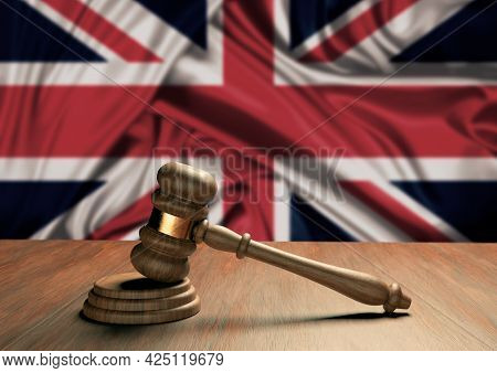 Wooden Judge's Gavel Symbol Of Law And Justice With The Flag Of England. English Supreme Court. 3d R