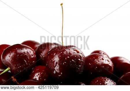 Ripe Juicy Petioles On A White Background. Ripe Cherries Background.