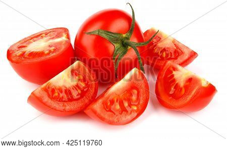 A Whole Red Tomato And Pieces Of Tomato Are Isolated On A White Background. Full Clipping Path.