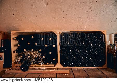 Wine Cellar With Wine Bottles In Wooden Crates