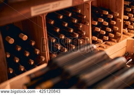 Bottles Of Wine With Corks Stored In Wine Cellar