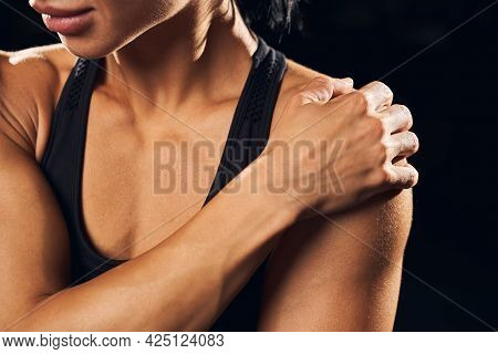 Young Female Athlete Is Experiencing Shoulder Cramps