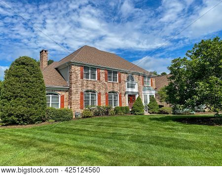 Single Family Suburban Brick House In An Affluent Neighborhood In New Jersey.