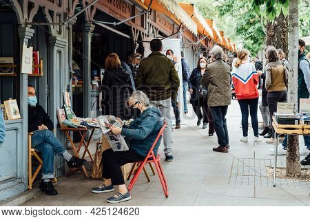 Madrid, Spain - April 24, 2021: People In The Old Book Fair In Cuesta De Moyano. It Is Famous For Th