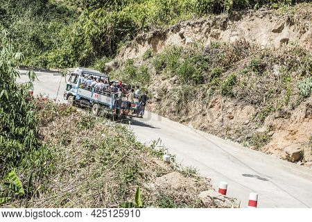 KYAIKTIYO, MYANMAR - JANUARY 23, 2016: Completly full truck transporting buddhist pilgrims from Kinpun base camp up to the hill to Kyaiktiyo Pagoda golden rock shrine.