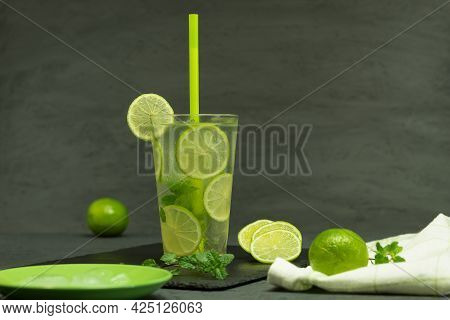 A Glass Of Lemonade And Ice With Lime. Homemade Mojito Lemonade, With Lime And Mint In A Glass Jar O