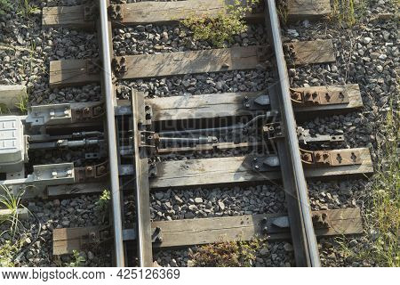 Mechanical Turnout Switch Of Railway Tracks. The Mechanism Is Modern, Electric Railroad Switch. Clos