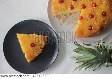 Slice Of Caramelised Pineapple Upside Down Cake. Home Baked Pineapple Cake With Pineapple Slices Are