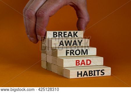 Time To Break Bad Habits. Wooden Blocks With Words 'break Away From Bad Habits'. Businessman Hand. B