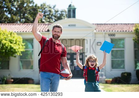 Father And Son Excited After School. Beginning Of Lessons. First Day Of Fall.