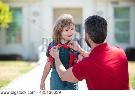 Father Getting Son Wearing School Uniform Ready For First Day Of School. Funny Nerd. School Boy Goin