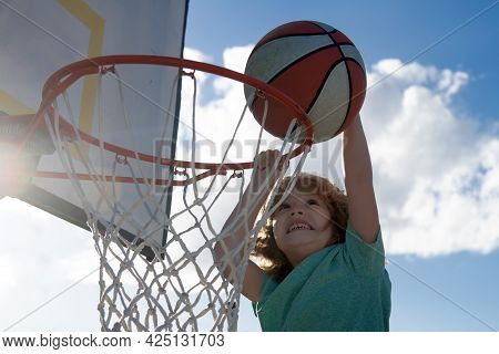 Kids Playing Basketball. Child Sport Activity. Healthy Children Lifestyle. Closeup Face Of Kid Baske