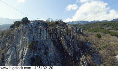 Top View Of Rocky Terrain Of Mountains. Shot. Fly Through Beautiful Rocky Mountain Slopes With Varie
