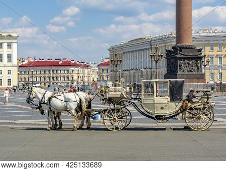 Saint Petersburg, Russia - June 2021: Horse Carriage On Palace Square
